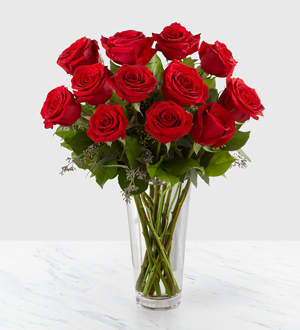 long stemmed red roses in a vase
