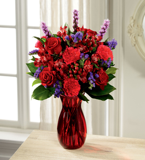 Bouquet of Red and purple flowers in a red vase
